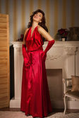 Fashionable lady in a red dress — Stock Photo