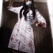 Stock Photo: Crazy dead nurse with knife in hand