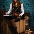 Steam punk girl and old typewriter — Stock fotografie