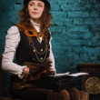 Steam punk girl and old typewriter - Stok fotoğraf