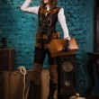 Steam punk girl with suitcase — Stockfoto