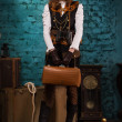 Steam punk girl with suitcase — Stock Photo