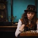 parní punk dívka hraje šachy — Stock fotografie