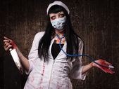 Crazy dead nurse with knife in the hand — Stock Photo