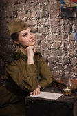 Soviet female soldier in uniform of World War II dreams — Foto Stock