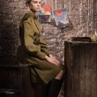 Soviet female soldier in uniform of World War II in the dugout — Stock Photo