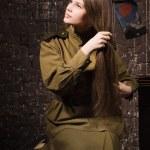 Soviet female soldier of World War II combs her hair — Stock Photo