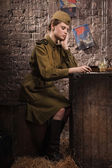 Soviet female soldier in uniform of World War II reads the lette — Stock Photo