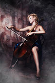 Beauty woman in evening dress playing cello — Stock Photo