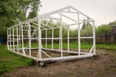 Construction of a small greenhouse — Stock Photo