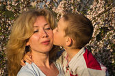 Mother and her little son in a spring garden — Stock Photo
