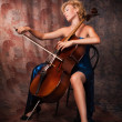 Stock Photo: Beauty womin evening dress playing cello
