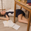 Stock Photo: Lifeless college girl on floor