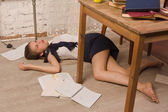 Lifeless college girl on a floor — Stock Photo