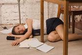Lifeless college girl on a floor — Stock Photo