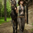 Cowgirl and brown horse — Stock Photo