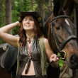 Cowgirl with brown horse — Stock Photo #28101861