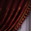 Red curtain drape tied — Stock Photo