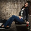 Pretty brunette woman in leather jacket — Stok fotoğraf