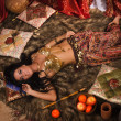 Beautiful belly dancer in the arabic harem interior — Stock Photo #30137143