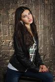 Pretty brunette woman in leather jacket — Stock Photo
