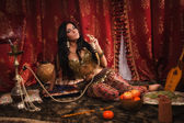 Beautiful arabic woman with hookah — Stock Photo