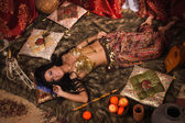 Beautiful belly dancer in the arabic harem interior — Stock Photo