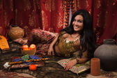 Beautiful woman in the arabic harem interior — Stock Photo