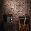 Stock Photo: Electric guitar and old amplifier