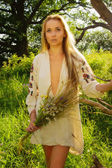 Pretty woman in the summer forest — Stock Photo