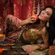 Beautiful belly woman in the arabic harem interior — Stock Photo