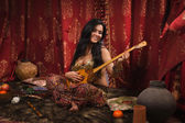 Beautiful woman playing the dombra — ストック写真