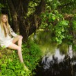 Pretty woman on the forest lake — Foto Stock