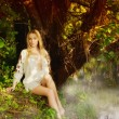 Pretty woman on the forest lake — Stockfoto