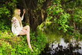 Pretty woman on the forest lake — Stock Photo