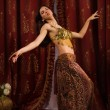 Arabic belly dancer dancing — Stock Photo