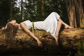 Slavonian girl in the deep forest — Stock Photo