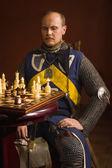 Knight plays chess — Stock Photo