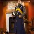 Knight with sword against fireplace — Stock Photo #35322859