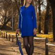 Pretty blonde in autumn park — Foto Stock