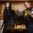 Knight plays chess with death — 图库照片