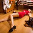 Stock Photo: Victim of armed robbery lying on floor