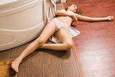Crime scene simulation. Lifeless girl lying on the floor — Stock Photo