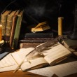 Old books and candles on wooden table — Stok fotoğraf