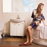 Beautiful woman in the bathroom — Stock Photo