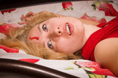 Crime scene simulation: innocence victim on the bed — Stock Photo