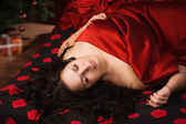 Sexy brunette lying on the bed — Stock Photo