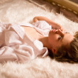 Sexual woman lying on the bed — Stock Photo #39492625