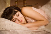 Pretty girl sleeping on the bed — Stock Photo