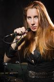 Rock star girl singing in a studio — Stock Photo